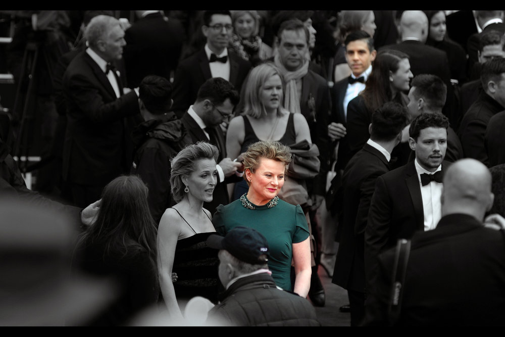"Monica Dolan  (in green at long range) won  Best Supporting Actress  for her role in ""All About Eve"". Meanwhile, at even longer range, the blurry guy in the background * might*  be Matthew Lopez who won for Best New Play for ""Inheritance"" on the night."