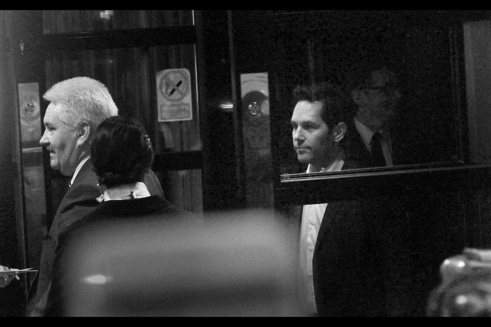 Paul Rudd. The only shot I have of him that isn't blurry (he glanced infinitesimally in our direction, almost guiltily, en route to his limo) - shot through darkened glass. He was paused at the door waiting to the limo to arrive, like he was a plane being launched from an aircraft carrier.