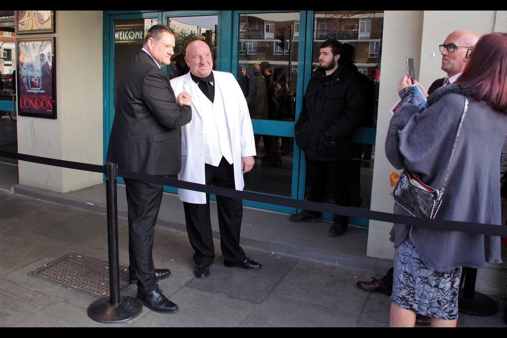 Wireimage suggests that the man in the white jacket might be Dave Courtney, but this is probably the kind of event where it's unwise to misidentify anyone. So this is… uh…. erm….