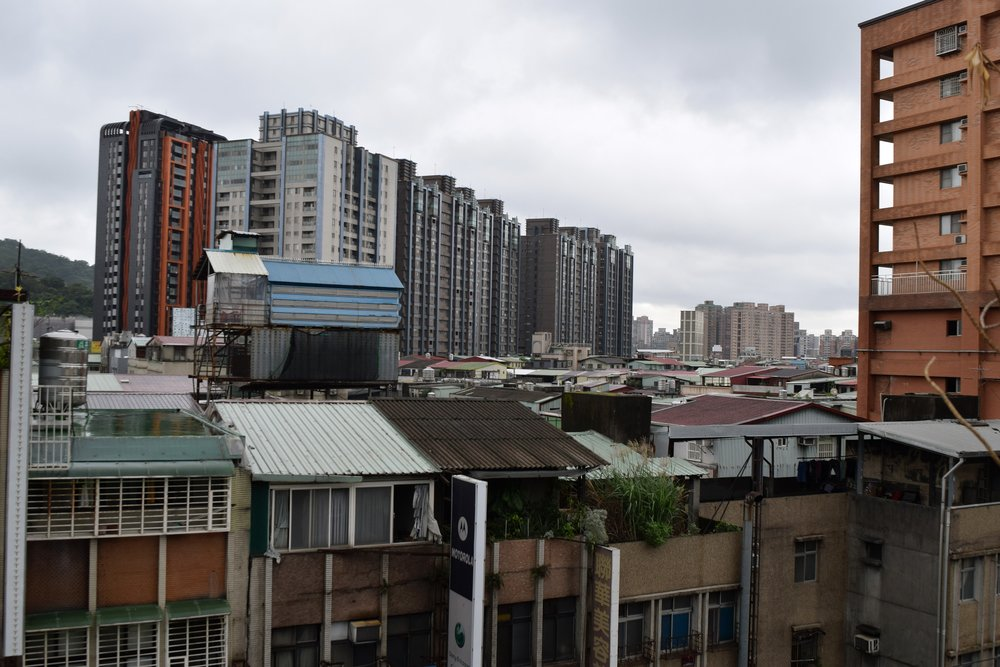 Ramshackle rooftop housing clutters the Taipei skyline. Photo: Morley J Weston.