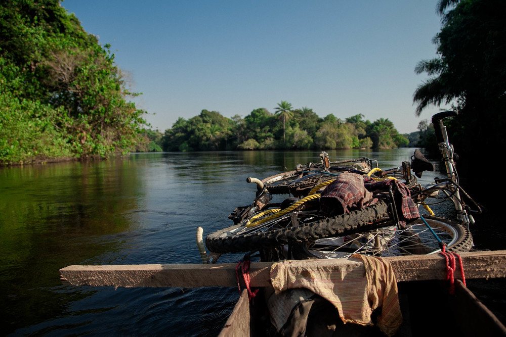 Bicycles onboard on our trusty pirogue that cost us $160 with only a few leaky holes.
