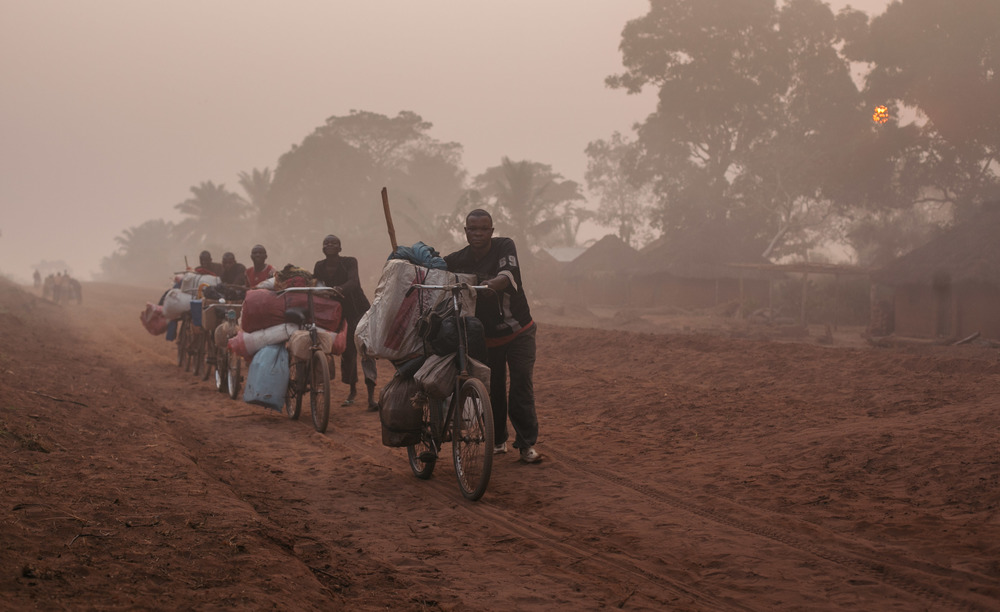 With the roads in such a terrible state of decay, the main mode of goods transport is with these tough porters who push their loads along the sandy trail hoping for a bit of downhill during which to jump on their bicycles. They often travel several hundred kilometres.