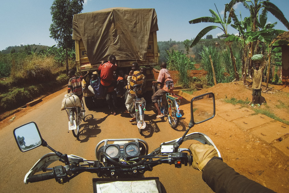 Locals hitch a ride up the rolling hills of Burundi.