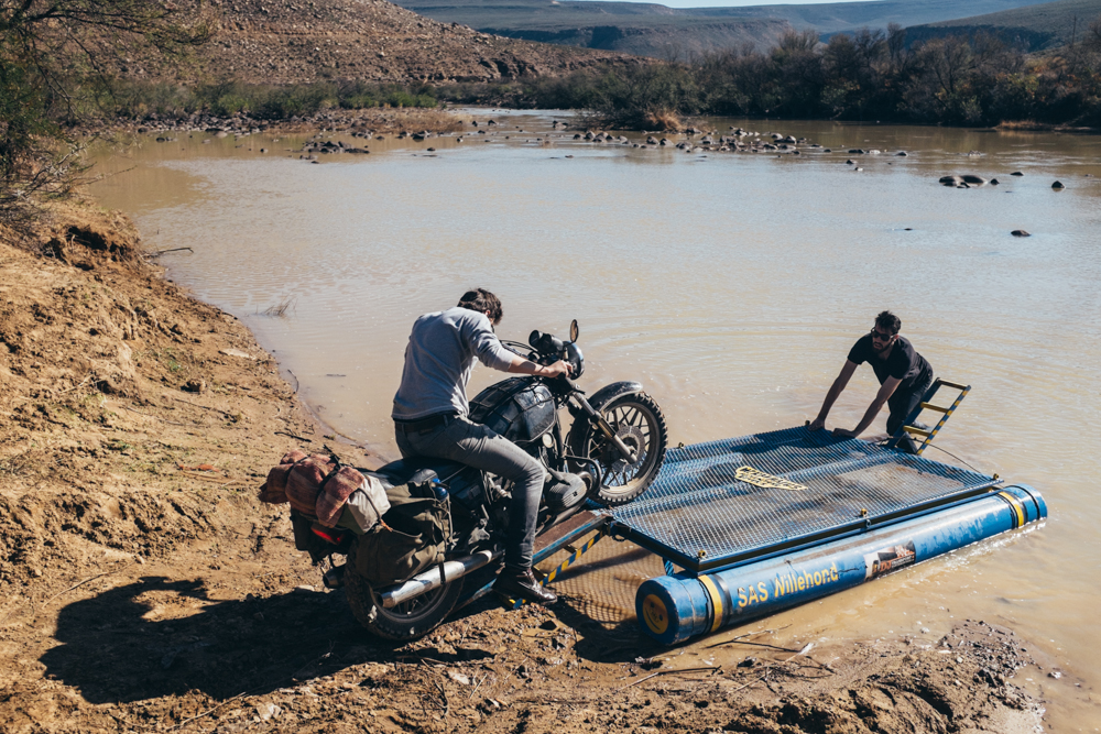 Winter rain had made the Doring River impassable. Luckily, we found a raft on the riverbank with just enough buoyancy to take the bikes across