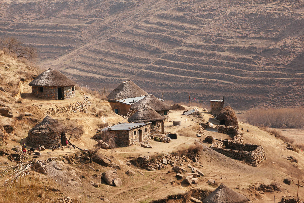 Traditional round 'M  okhoro' huts built into the hillside