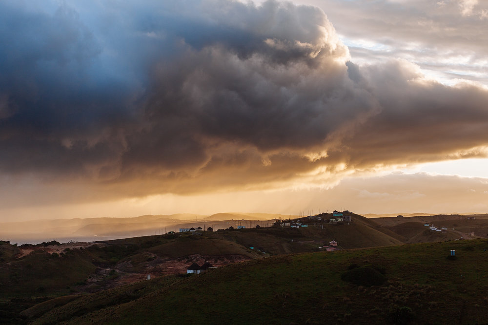 A storm rolls in across the village of Tshani.