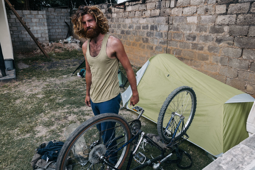 While we wait for our visas in Lusaka, Charlie gets his bike ready for the first leg of the trip.
