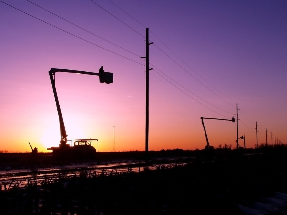 Bucket Trucks at sunset Source Dave Behle Dawson Public Power District 2007.jpg