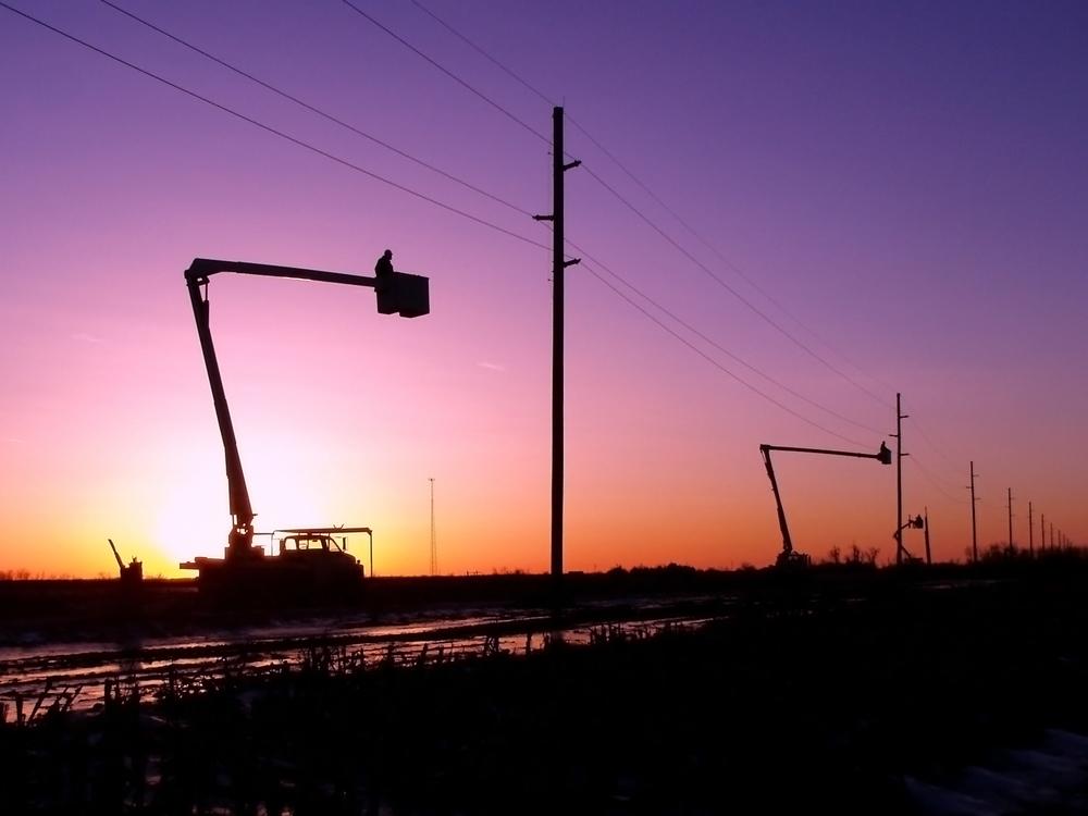 Bucket Trucks at sunset Source Dave Behle Dawson Public Power District 2007.jpg