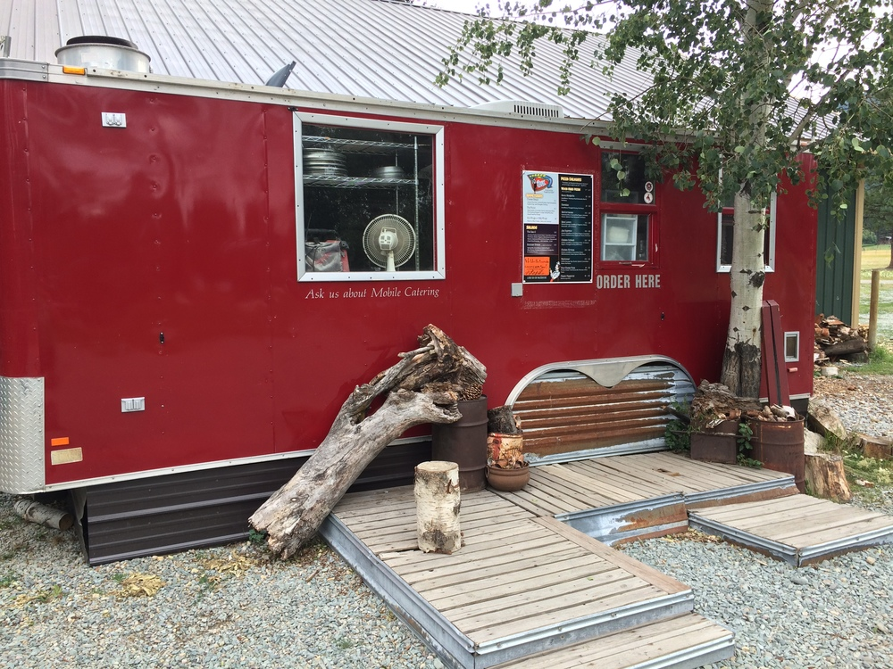 on-site food truck serves pizzas and more year round