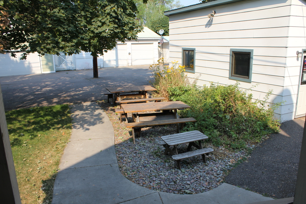 bACKYARD OF THE NORTH VALLEY MUSIC SCHOOL WITH PICNIC TABLES FOR ALL AGES