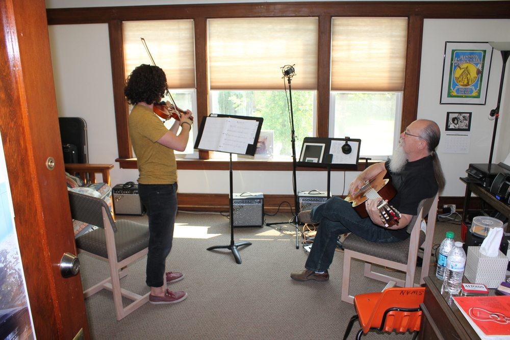 CHRISTIAN JOHNSON IN A LESSON WITH ONE OF HIS VIOLIN STUDENTS. CHRISTIAN TEACHES SEVERAL INSTRUMENTS AT NORTH VALLEY MUSIC SCHOOL