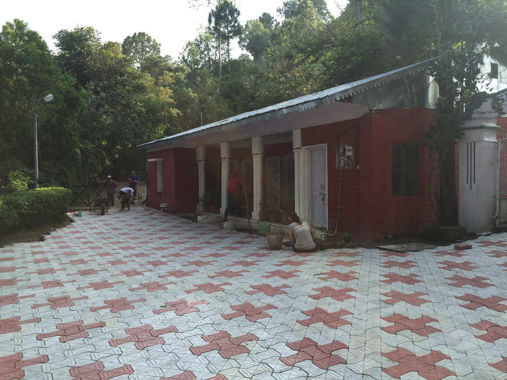Paving guesthouse area.jpg