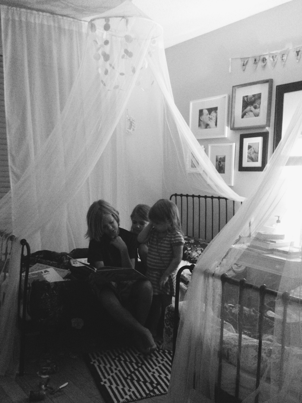 Reading to His Sisters, by Stacey Woods