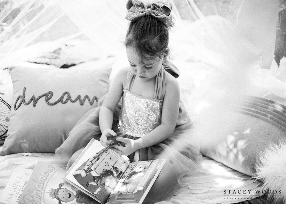 Reading stories under a lighted canopy  || Stacey Woods, Clearwater Florida child photographer