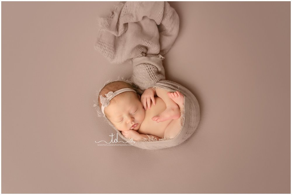 "Newborn ""hanging"" pose 