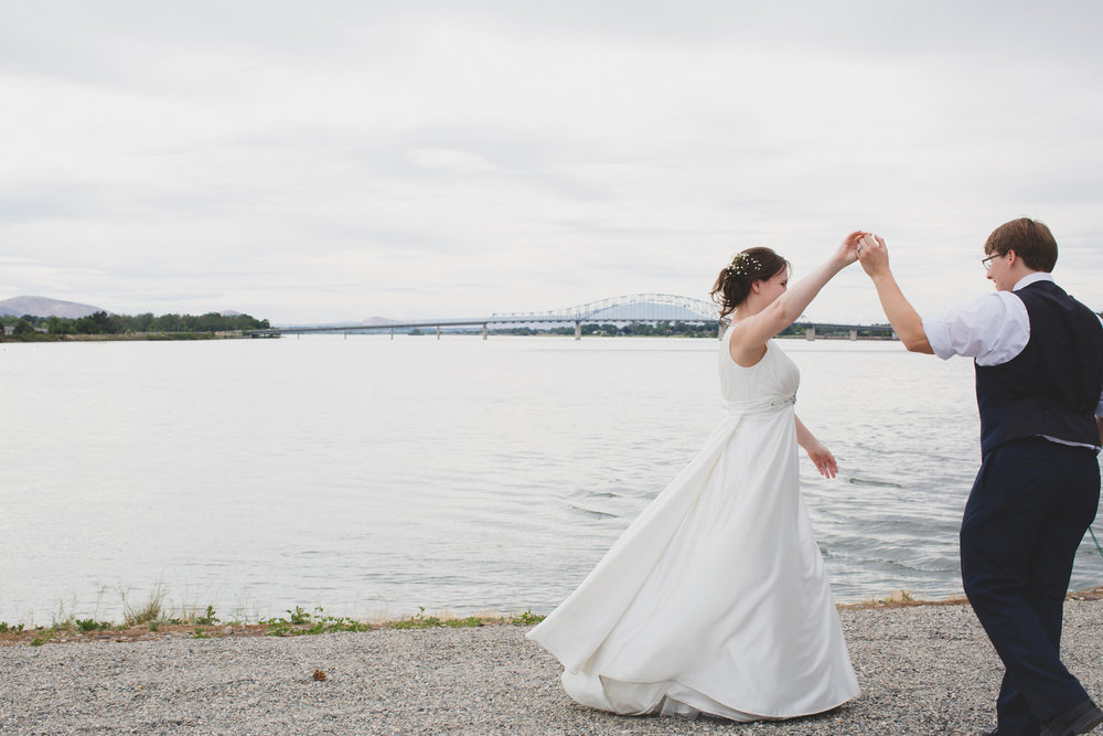 Tri Cities Wedding Photographer_Karis and Adrienne_Church wedding_ Downtown Kennewick 11_Clover Island_Bride and groom dancing