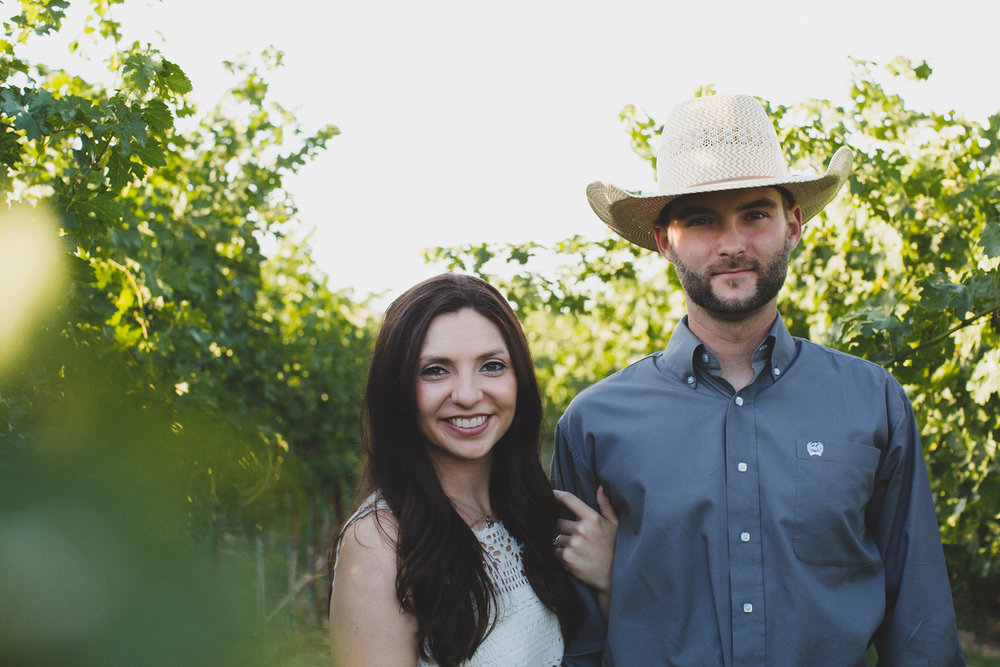 Tri Cities sunset engagement session_desert engagement_Vineyard engagement_Jordyn and Drew_Jordan Edens Photography_JEP_Grape vines_cowboy hat_6