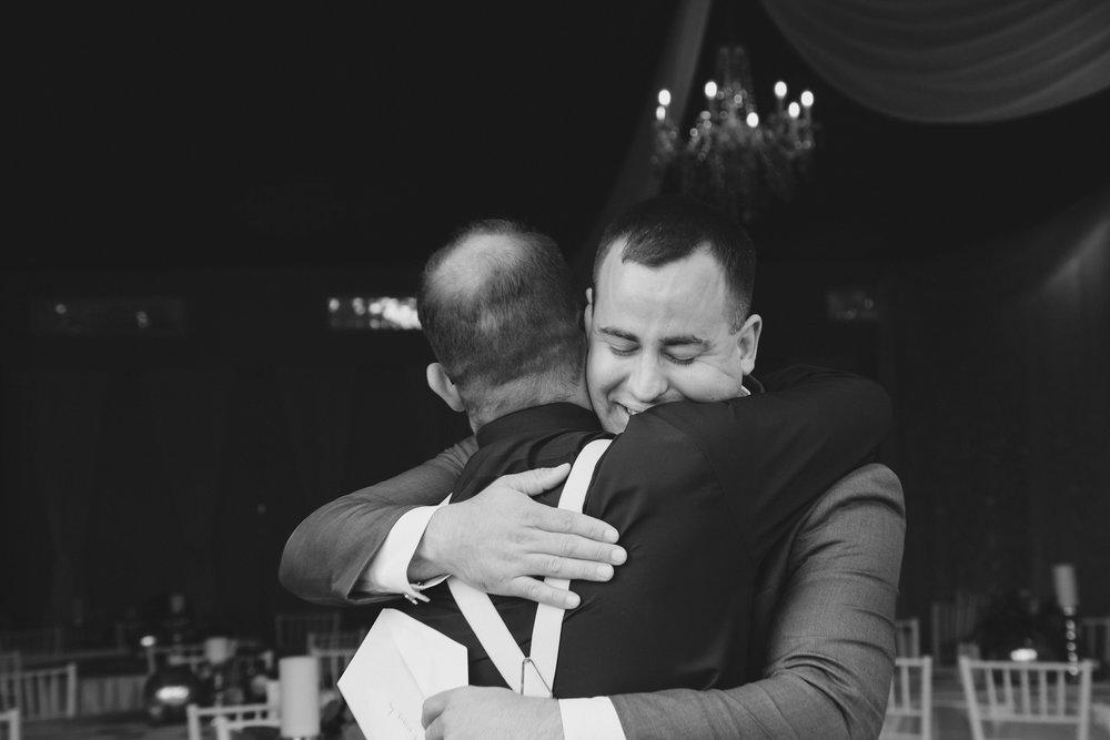 Bella Fiori Gardens_Matt Minch and Tayler Herman_Tri Cities Wedding_Washington Wedding_Tri Cities Photographer_Outdoor Tri Cities Wedding_Garden wedding_Bride and groom pose_kennewick wedding_Jordan Edens Photography_groom_hug