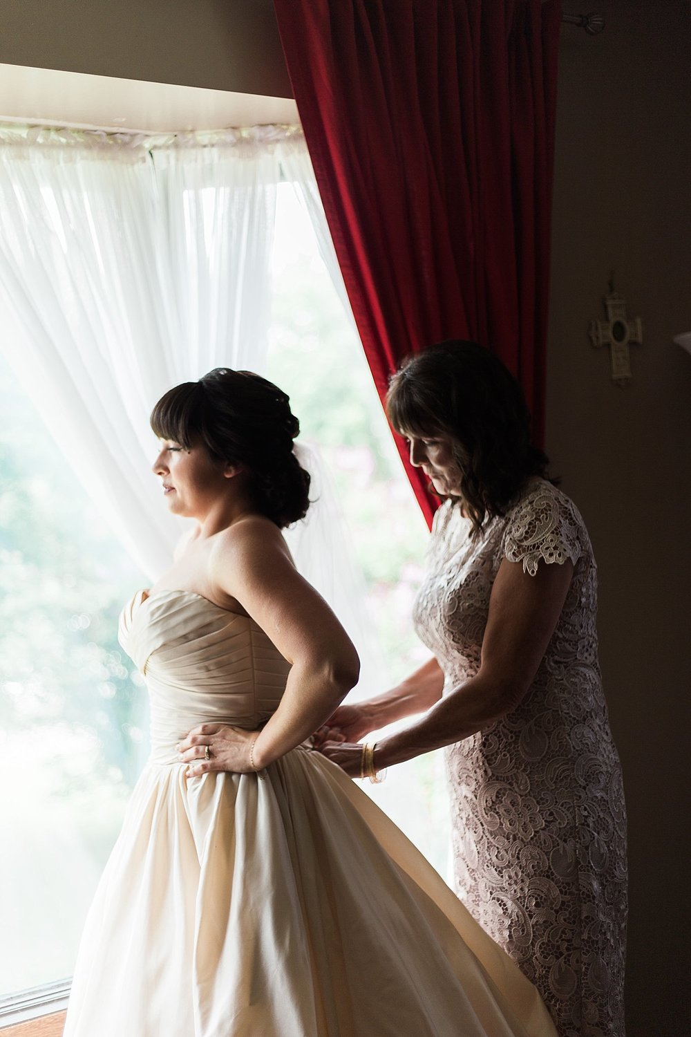 RCMP Wedding - Winnipeg Wedding Photographer - Mother helping put wedding dress on - Keila Marie Photography