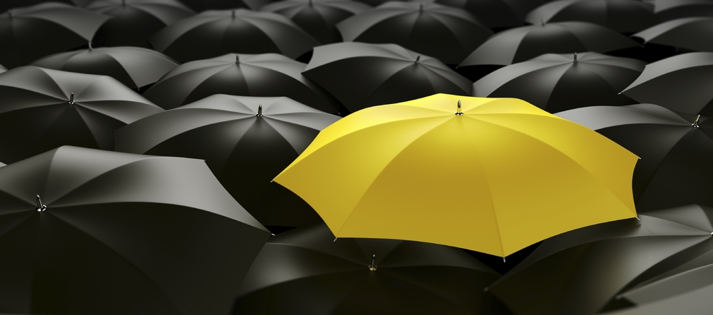stock-photo-6218863-yellow-umbrella.jpg