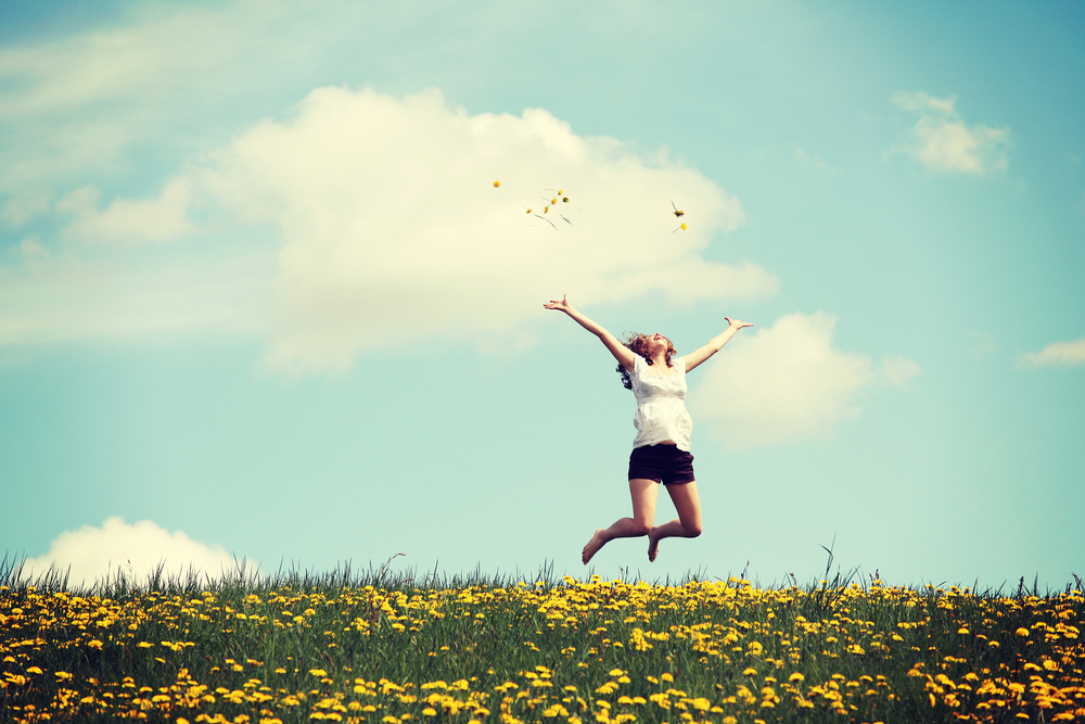 bigstock-Happy-woman-jumping-on-blossom-59295572.jpg