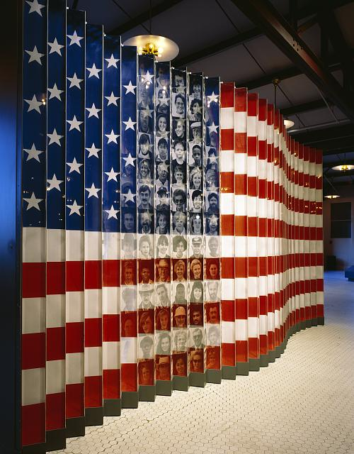 Ellis Island Flag and Faces, Exhibit photograph, Ellis Island, New York, New York (1980). Carol M Highsmith. Photograph in the Carol M. Highsmith Archive, Library of Congress, Prints and Photographs Division.