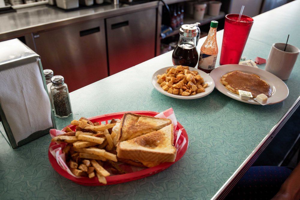 Patty melts and pancakes for breakfast.