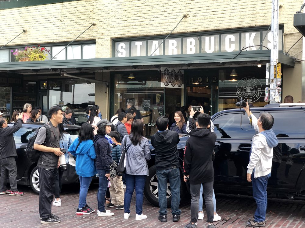 The crazy long line at the first Starbucks.
