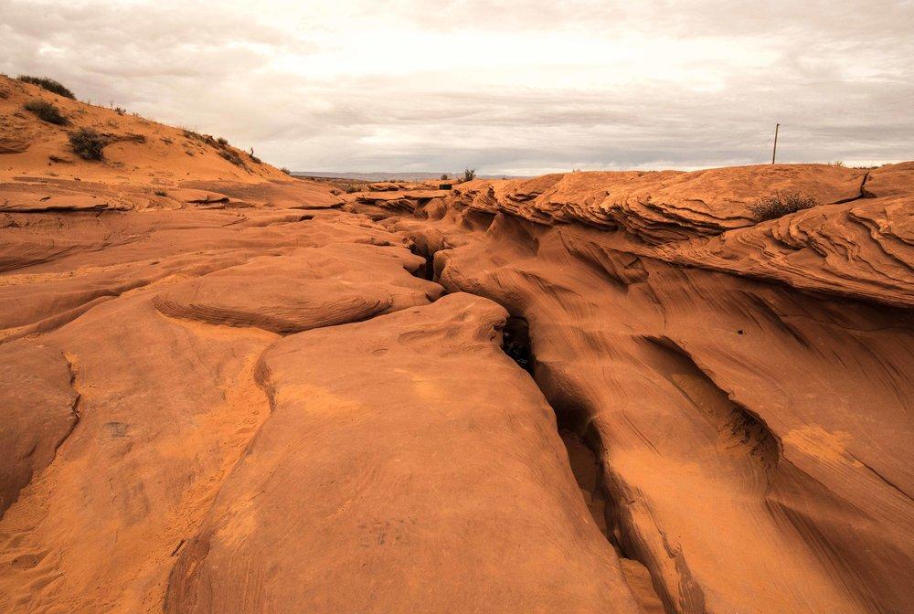 You enter the canyon through cracks in the ground.