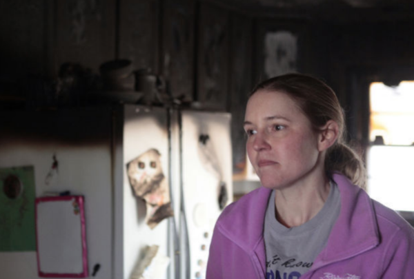 Jessica in her fire damaged kitchen.