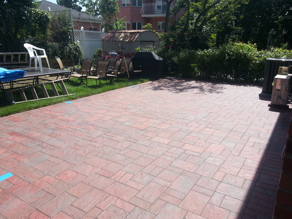 3 piece pavers with locking sand in the joints and a semi gloss sealer.