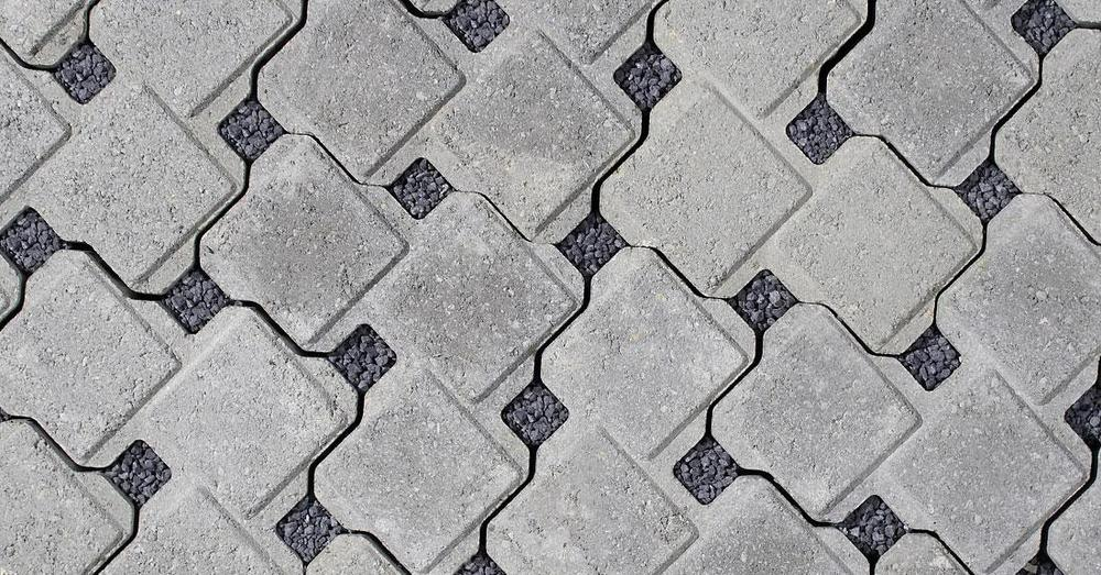 Pervious pavers with crushed stone in the voids that allow water to pass through surface like a drain.