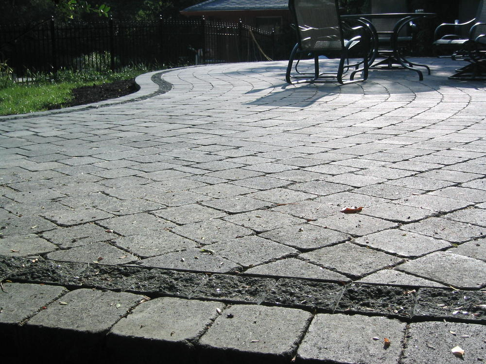 Rustic look pavers with a split face border.