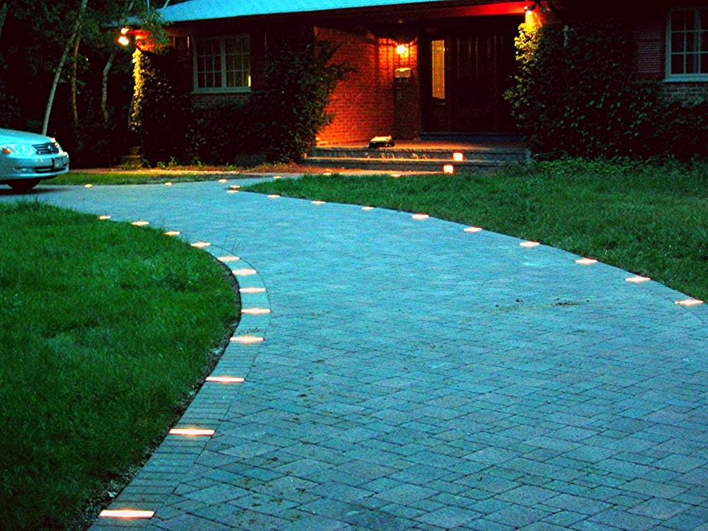 Circular Driveway with 3 piece pavers and low voltage lighting.