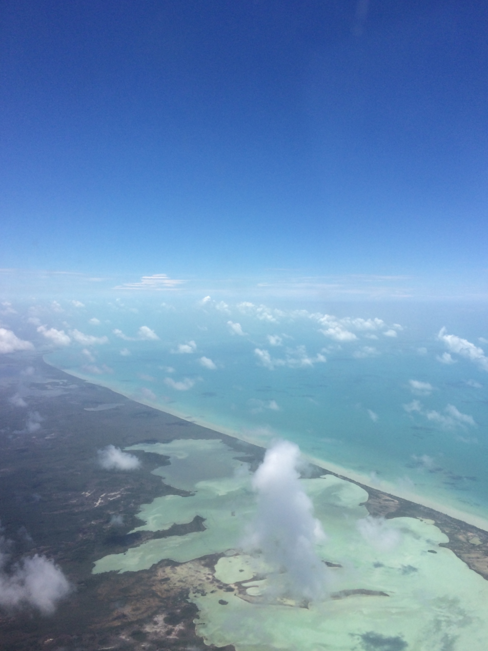 This is from our flight back from Belize last summer. Our next trip takes us to Mexico, and I'm pretty psyched, I cannot wait for more of these crystal clear blue waters.