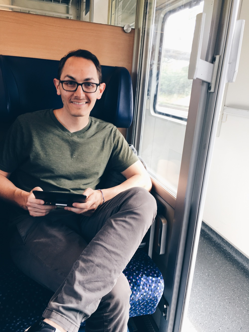 On the train to Prague, on a train with a compartment (btw, he is playing Pokemon,  BEFORE  pokemon go even came out, on an old school Nintendo, that couldn't even be charged there.
