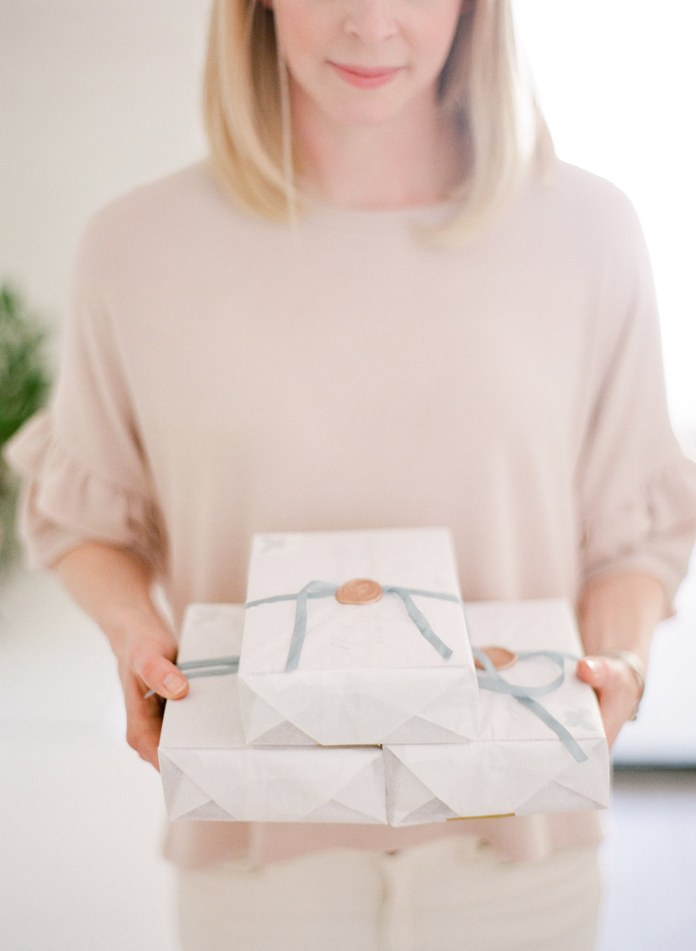 When we ship out a completed suite each piece is carefully wrapped in tissue and ribbon (with our own sable and gray seal!) to make it even more special when it arrives.