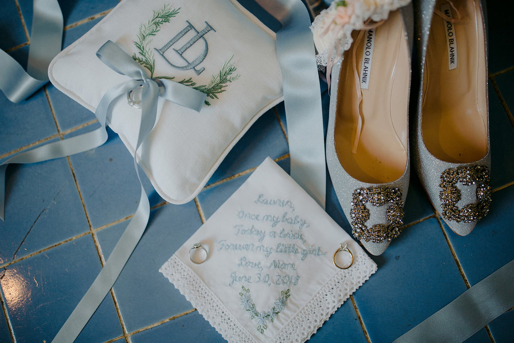 Lauren used the custom crest that we created for her in multiple creative ways, seen here embroidered on a beautiful ring pillow.