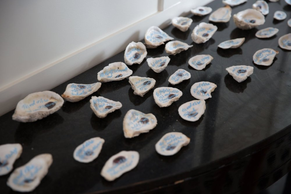 custom oyster shell wedding escort cards by sable and gray