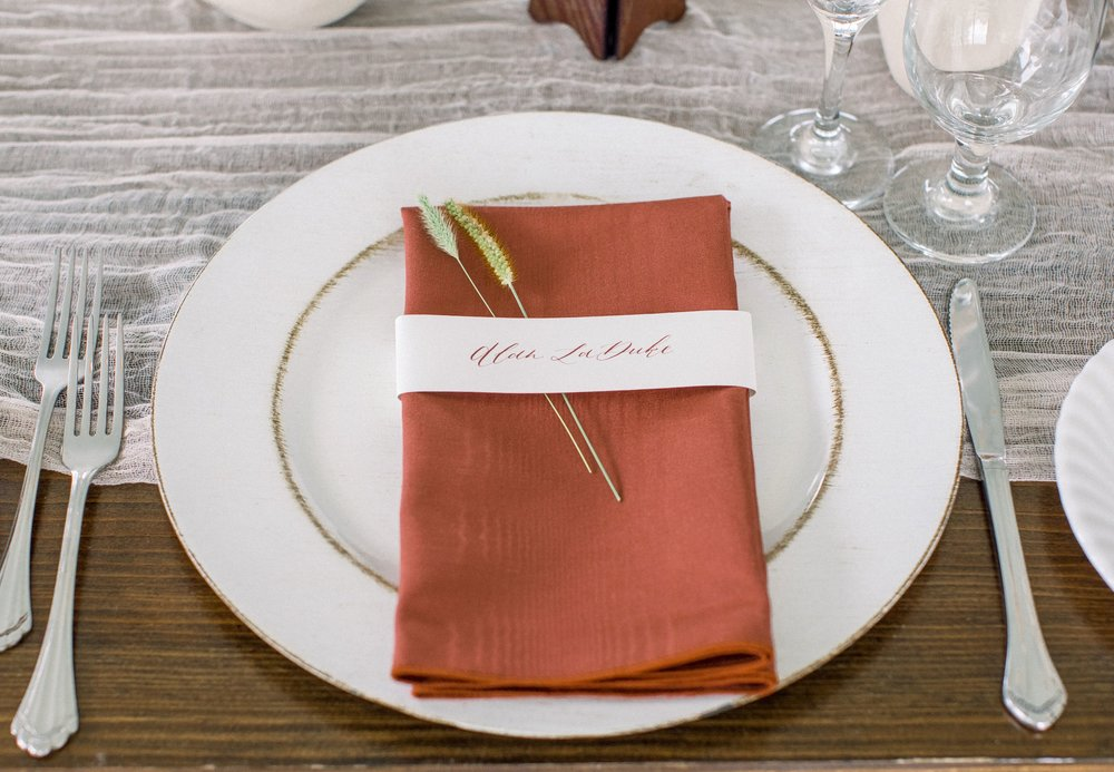 custom calligraphy napkin wrap place cards by sable and gray
