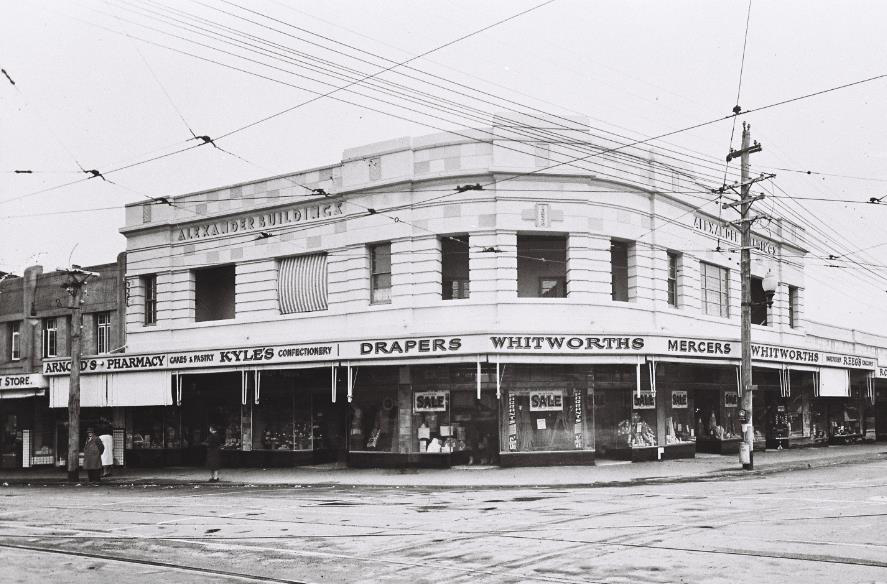 Arnold's Pharmacy – to the left of the photo