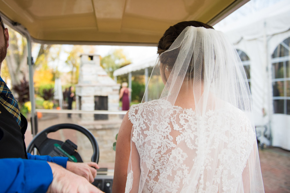 The royal treatment  - Molly rode in a golf cart on her way to surprise Ryan for their 'first look' pre-ceremony