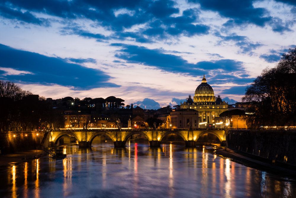 St. Peter's Basilica & The Tiber River after sunset.