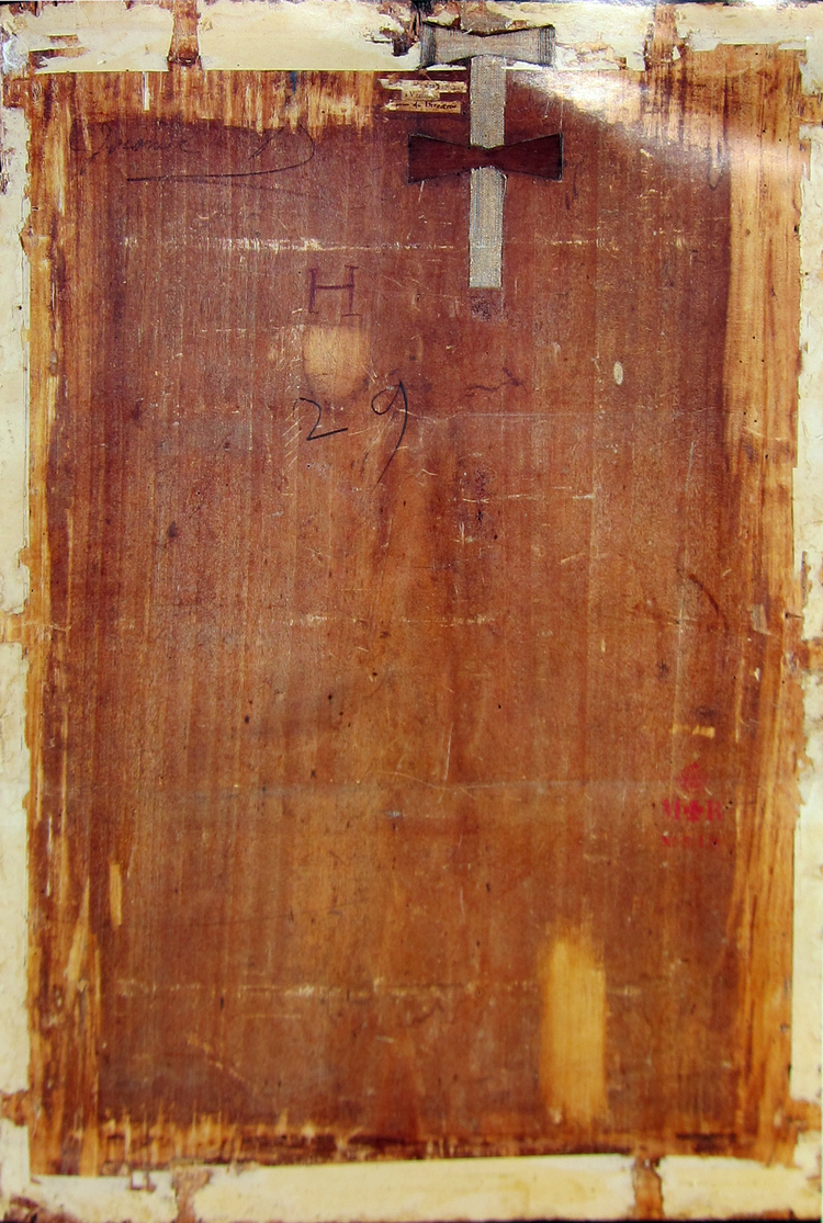 The back panel of the Mona Lisa. Notice the butterfly brace that is keeping a crack from spreading.