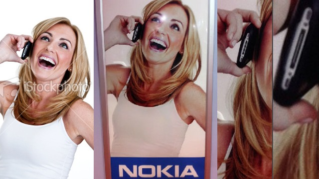 jackyan :      dashperiod :     Nokia uses iPhone in their ad picture. Oh dear Stock Photography…    via Gizmodo       Nokia uses Iphone  Bad move on Nokia's part.      Ah, stock photography.  At first I thought this was just showing the same lady laughing in an Apple ad and a Nokia ad, but this is possibly worse (if true)…