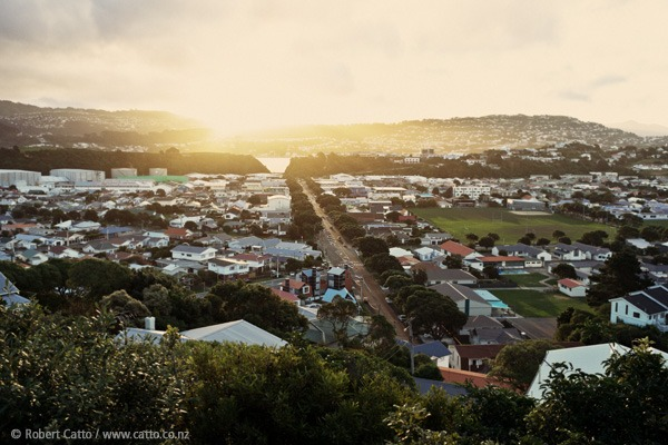"Another late-winter-sun Seatoun Heights special - this is looking back over Miramar from Townsend Road, with Miramar Avenue running down the middle towards the Cutting.  The giant green screen on the left is of course Stone St Studios, where they're working on  The Hobbit  currently - and the  Roxy  is just to the right of the main drag.   I was listening to Simon & Garfunkel on this walk (out for a stroll on my own, for a change) - after seeing  The Sound Of Silence  in last year's  NZ International Arts Festival , all the songs seem different to me now.  ""Can analysis be worthwhile?"" ""Is the theater really dead?""  Indeed."