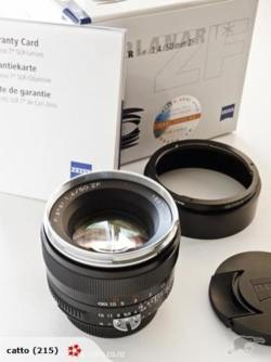 One more Trademe listing this week, it's just a  Zeiss 50mm ZF Planar T* lens  I decided to try in January - turned out (while it's a cracking little lens) it's great for video, but wouldn't really suit the rest of what I do as well as I'd hoped.  So, I got the Canon f/1.2L instead - and this one's back on the market!   Also just relisted the  Sigma 12-24mm  - everything else sold last week!  And these are photos of the actual lenses, naturally.  (We just have a very photogenic kitchen table, as it turns out…)