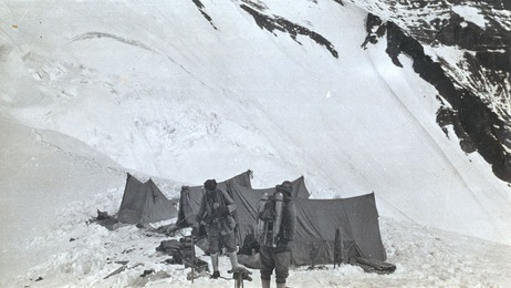 From  NPR's Picture Show : An old, washed-out photograph shows two men at the edge of a snowy  abyss, clad in rudimentary mountaineering gear. Those men are George  Mallory and Andrew Irvine, and the photo is the last known photo ever  taken of them. It was snapped before they disappeared into the clouds of  Mount Everest on June 8, 1924.   The  British climbers were on a mission. They wanted to become the first  people to stand atop the world's tallest mountain — three decades  before  Sir Edmund Hillary made his landmark climb. But after they set out, no one knows exactly what happened to them.   Kent Moore might have found the answer…