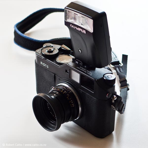 I'm actually just posting this photo so I can talk about it on the  Rangefinder Forum  page for the camera - but while I'm at it, this is my favourite camera at the moment, the  Epson R-D1s .   Yes, Epson made cameras - in this case, a kind of bastardised  Voigtlander  Bessa rangefinder with a Leica M-Mount lens fitting, so classic lenses dating back to ~1930 could be used with it, and the sensor from a Nikon D100. They actually came out ahead of the Leica M8, at a time when Leica were claiming that a digital rangefinder was either impossible, or something their buyers wouldn't want.   The hilarious thing is that the Voigtlander shutter required cocking, so you still have to 'wind on' with this camera - note the huge thumb lever at left - as well as manually focussing and stopping down the lens.  It's very old-school manual photography, but with the option to chimp…I love it.  (That's not to say I don't want an  M9  eventually, of course!)
